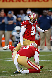 SANTA CLARA, CA - DECEMBER 17: Kicker Robbie Gould #9 of the San Francisco 49ers kicks the game winning field goal on a hold from Bradley Pinion #5 during the fourth quarter against the Tennessee Titans at Levi's Stadium on December 17, 2017 in Santa Clara, California. The San Francisco 49ers defeated the Tennessee Titans 25-23. (Photo by Jason O. Watson/Getty Images) *** Local Caption *** Robbie Gouldl; Bradley Pinion