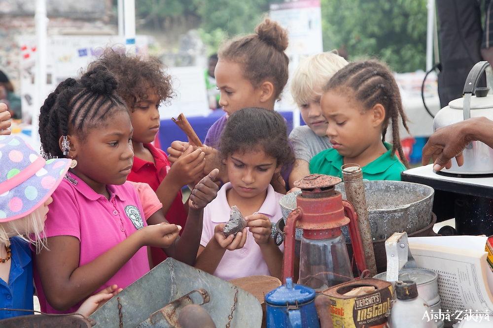 """First graders from Gifft Hill School sample old tools and implements.  The Virgin Islands National Park Service presents the 26th Annual Folk-life Festival """"Celebrating Transfer Day from the Danish West Indies to the United States Virgin Islands""""  Annaberg Sugar Plantation Ruins.  23 February 2017.  © Aisha-Zakiya Boyd"""