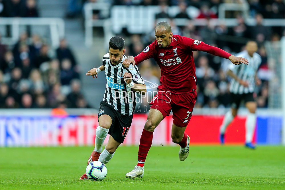 Ayoze Perez (#17) of Newcastle United takes on Fabinho (#3) of Liverpool during the Premier League match between Newcastle United and Liverpool at St. James's Park, Newcastle, England on 4 May 2019.