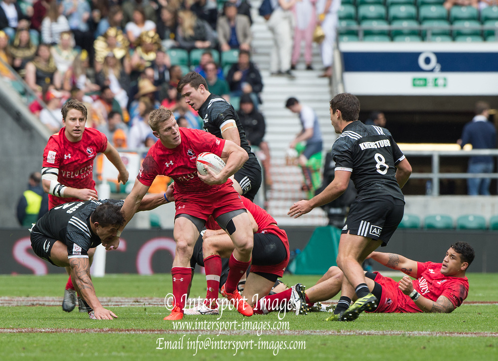 """Twickenham, Surrey United Kingdom. Canadian,  John MOONLIGHT, hold off, NZ's Trael JOASS, before confronting, Andrew KNEWSTUBB,  during the  Poll C match, Canada vs New Zealand, at the  """"2017 HSBC London Rugby Sevens"""",  Saturday 20/05/2017 RFU. Twickenham Stadium, England    <br /> <br /> [Mandatory Credit Peter SPURRIER/Intersport Images]"""