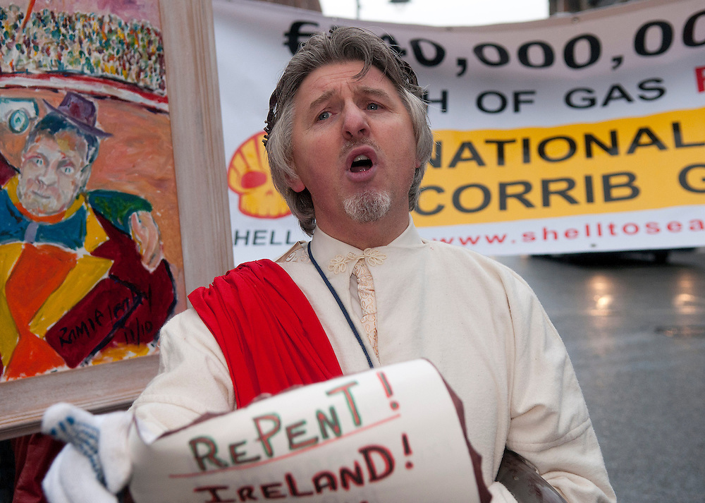 """""""Robbie,"""" In protest of the Irish """"government's wrongs,"""" reads from a scroll in Dublin, Ireland, demanding the government repent for its sins on 7/12/2010."""