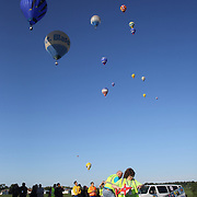 Officials measure marker drops in rural Michigan near Battle Creek during the World Hot Air Ballooning Championships. Battle Creek, Michigan, USA. 18th August 2012. Photo Tim Clayton