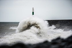 © Licenbsed to London News Pictures. Aberystwyth Wales UK, Friday 12 October 2018. UK Weather: Storm Callum. the third named storm of the UK season, hits Aberystwyth on the west wales coast, with ferocious waves crashing into the harbour wall and lighthouse. Photo  credit: Keith Morris / LNP