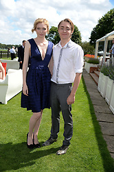ELEANOR TOMLINSON and her brother ROSS TOMLINSON at the Audi International Polo at Guards Polo Windsor Great Park, Egham, Surrey on 28th July 2013.