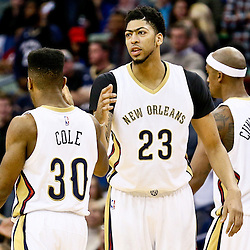 Feb 10, 2016; New Orleans, LA, USA; New Orleans Pelicans forward Anthony Davis (23) celebrates with guard Norris Cole (30) and forward Dante Cunningham (44) during the second half of a game against the Utah Jazz at the Smoothie King Center. The Pelicans defeated the Jazz 100-96. Mandatory Credit: Derick E. Hingle-USA TODAY Sports