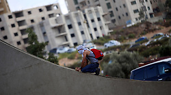 08.10.2015, Ramallah, PSE, Gewalt zwischen Palästinensern und Israelis, im Bild Zusammenstösse zwischen Palästinensischen Demonstranten und Israelischen Sicherheitskräfte // A Palestinian protester sits on a wall during clashes with Israeli security forces in Beit El, near the West Bank city of Ramallah. New violence rocked Israel and the Israeli occupied West Bank, including an incident in which men thought to be undercover Israeli police opened fire on Palestinian stone throwers they had infiltrated, wounding three of them, Palestine on 2015/10/08. EXPA Pictures © 2015, PhotoCredit: EXPA/ APAimages/ Shadi Hatem<br /> <br /> *****ATTENTION - for AUT, GER, SUI, ITA, POL, CRO, SRB only*****