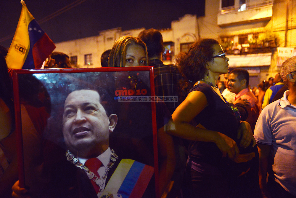 CARACAS - MARCH 05, 2013: Backers of President Hugo Chavez waiting outside military hospital after knowing the news of his death. Chavez had cancer since 2011 which failed to recover after four operations in Cuba. (Photo by Gregorio Marrero)