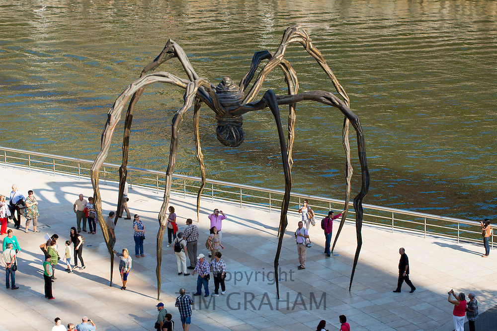 Spider bronze sculpture 'Maman' by Louise Bourgeois and tourists at Guggenheim Museum in Bilbao, Basque country, Spain
