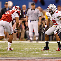 January 4, 2011; New Orleans, LA, USA; Ohio State Buckeyes defensive back Christian Bryant (2) in coverage against Arkansas Razorbacks wide receiver Julian Horton (2) during the second quarter of the 2011 Sugar Bowl at the Louisiana Superdome.  Mandatory Credit: Derick E. Hingle