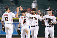 PHOENIX, AZ - JUNE 26:  Nick Ahmed #13, David Peralta #6 and Chris Herrmann #10 of the Arizona Diamondbacks celebrate after defeating the Philadelphia Phillies 6-1 at Chase Field on June 26, 2017 in Phoenix, Arizona.  (Photo by Jennifer Stewart/Getty Images)