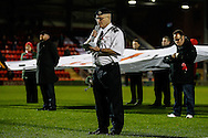Former Leyton Orient and Northampton Town players that gave their life for their country are remembered in a special half-time service to mark the 100th anniversary of the start of WWI during the Johnstone's Paint Trophy match at the Matchroom Stadium London,<br /> Picture by David Horn/Focus Images Ltd +44 7545 970036<br /> 11/11/2014