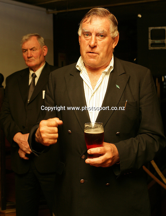 Colin Meads speaks with Sir Brian Lochore behind at the launch of the AA Rewards Heartland Championship at the Muddy Farmer Pub, Auckland, New Zealand on Friday 18 August, 2006. Photo: Hannah Johnston/PHOTOSPORT<br />
