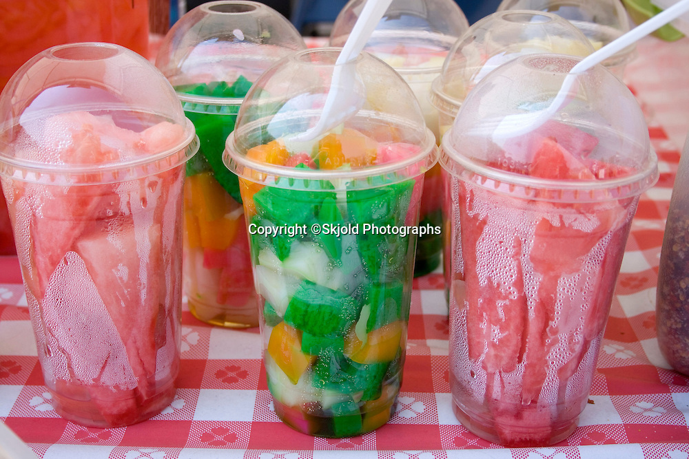 Colorful fruit cups for sale at food concession stands. Hmong Sports Festival McMurray Field St Paul Minnesota USA