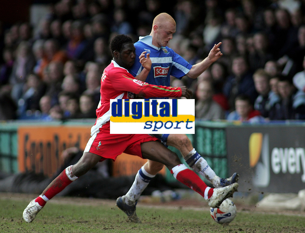 Photo: Paul Thomas.<br /> Stockport County v Swindon Town. Coca Cola League 2. 03/03/2007.<br /> <br /> Patrick Noubissie (L) of Swindon tries to tackle Jason Taylor.