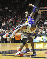 "Mississippi's LaDarius White (10) is fouled by LSU's Shavon Coleman (5) at the C.M. ""Tad"" Smith Coliseum in Oxford, Miss. on Wednesday, January 15, 2013. (AP Photo/Oxford Eagle, Bruce Newman)"