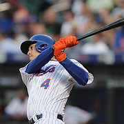 Wilmer Flores, New York Mets, drives in a run with a sacrifice fly during the New York Mets Vs Toronto Blue Jays MLB regular season baseball game at Citi Field, Queens, New York. USA. 16th June 2015. Photo Tim Clayton