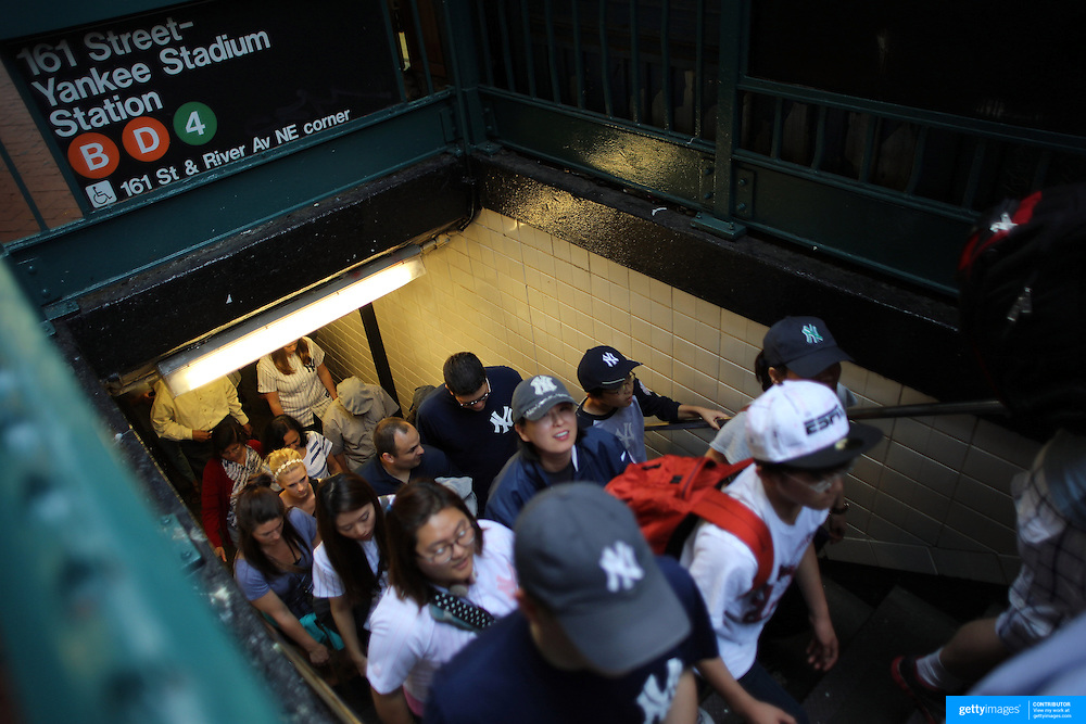 Fans arrive at 161 Street-Yankee Stadium Station for the New York Yankees V New York Mets Subway Series Baseball game at Yankee Stadium, The Bronx, New York. 8th June 2012. Photo Tim Clayton