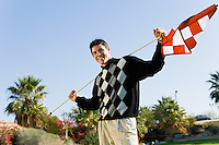 Young Man Holding Golf Flag