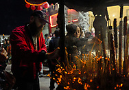 People burn incense at the Thien Hau temple to celebrate the first day of the Chinese Lunar New Year, the Year of the Dog, on Friday February 16, 2018, in Los Angeles, the United States. (Xinhua/Zhao Hanrong)<br /> 2月16日,农历正月初一凌晨,在美国洛杉矶,大批华人涌入中国城天后宫庙上香祈福。图为民众在庙前进香。新华社发 (赵汉荣摄) (Photo by Ringo Chiu)<br /> <br /> Usage Notes: This content is intended for editorial use only. For other uses, additional clearances may be required.