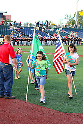 11 August 2012: Girl Scout Troop 28 (2082) handles the flag color guard duties during a Frontier League Baseball game between the River City Rascals and the Normal CornBelters at Corn Crib Stadium on the campus of Heartland Community College in Normal Illinois