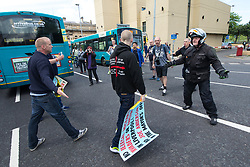 © Licensed to London News Pictures . 03/06/2017 . Liverpool , UK . EDL supporters and anti-fascists clash on the streets . Hundreds of police manage a demonstration by the far-right street protest movement , the English Defence League ( EDL ) and an demonstration by opposing anti-fascists , including Unite Against Fascism ( UAF ) . Photo credit: Joel Goodman/LNP