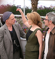 Denis Lavant, Kylie Minogue, Leos Carax at the Holy Motors photocall at the 65th Cannes Film Festival France. Wednesday 23rd May 2012 in Cannes Film Festival, France.