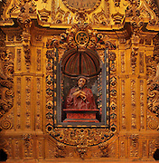 Ecce Homo statue with Christ with hands bound and wearing the crown of thorns, in a niche on one of the side altars, dedicated to Ecce Homo, 18th century, in the Capilla de San Torcuato, an octagonal chapel designed by Diego de Siloe, in Guadix Cathedral, or the Catedral de la Encarnacion de Guadix, begun 16th century and completed mid 18th century, in Baroque style, in Guadix, Andalusia, Southern Spain. Picture by Manuel Cohen