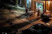 Everyday life photographies, taken during the night in the disadvantaged neighborhood of Guèdiawaye, in the suburbs of Dakar. Boutiques, people walking, cars in movement and lights.
