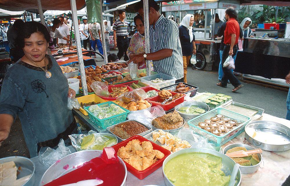 Kuih (local cakes)  seller, Malaysia...Photo: ©Ahmad Yusni.