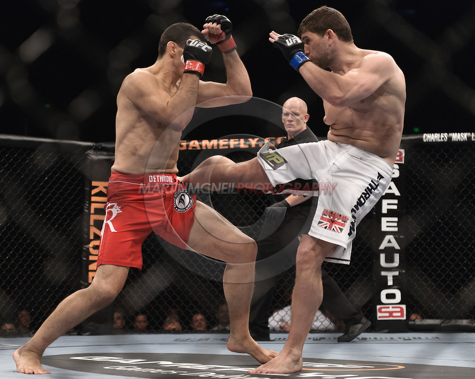 "SYDNEY, AUSTRALIA, FEBRUARY 27, 2011: Anthony Perosh (left) soaks up a kick from Tom Blackledge during ""UFC 127: Penn vs. Fitch"" inside Acer Arena in Sydney, Australia on February 27, 2011."
