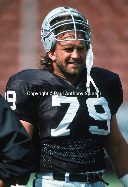 Los Angeles Raiders defensive lineman Mike Golic (79) looks on during the NFL football game against the Seattle Seahawks on Oct. 14, 1990 in Los Angeles. The Raiders won the game 24-17. (©Paul Anthony Spinelli)