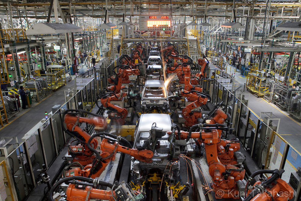 Robot arms assemble body frames at Ford factory in Chengalpattu, 40km south of Chennai, India on April 17, 2012.<br /> (Photo by Kuni Takahashi)