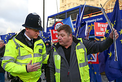 © Licensed to London News Pictures. 09/01/2019. London, UK. A police officer speaks with a pro-Brexit protester outside the Houses of Parliament as the Meaningful Vote debate begins. At the end of the five day debate the MPs will vote on Prime Minister, Theresa May's Brexit deal. Photo credit: Dinendra Haria/LNP