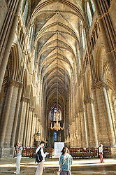 Interior of cathedral showing the cavernous interior space...Notre-Dame de Reims (Our Lady of Rheims) is the Roman Catholic cathedral of Reims France...Notre-Dame de Reims cathedral, the former Abbey of Saint-Remi, and the Palace of Tau were added to the list of UNESCO World Heritage Sites in 1991...HDR photo created from 5 RAW photos processed in Lightroom with Photomatix Plugin.
