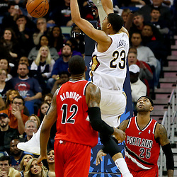 Dec 30, 2013; New Orleans, LA, USA; New Orleans Pelicans power forward Anthony Davis (23) dunks over \Portland Trail Blazers point guard Mo Williams (25) and power forward LaMarcus Aldridge (12) during the second half of a game at the New Orleans Arena. The Pelicans defeated the Trail Blazers 110-108. Mandatory Credit: Derick E. Hingle-USA TODAY Sports