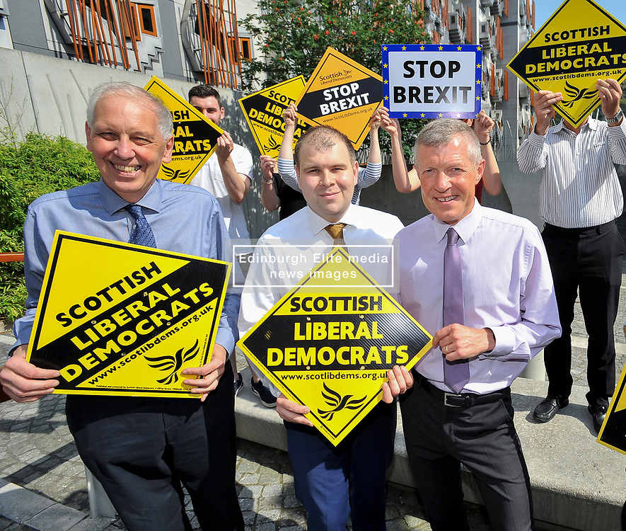 Pictured: Lib Dem councillor on South Lanarkshire council Robert Brown, councillor Mark McGeever and Willie Rennie.<br /> <br /> South Lanarkshire Conservative Councillor Mark McGeever has defected to the Scottish Liberal Democrats, following the election of Boris Johnson as the new Conservative leader and Prime Minister. He has represented Hamilton West and Earnock since 2017.<br /> <br /> © Dave Johnston / EEm