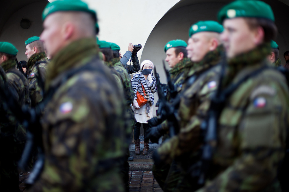 About 10000 Czech citizens accompanied the body of Vaclav Havel from the Old Town part in Prague across Charles Bridge   up to Prague Castle, the seat of Czech presidents. A woman watching soldiers attending the mourning procession for former President Vaclav Havel at Prague Castle.