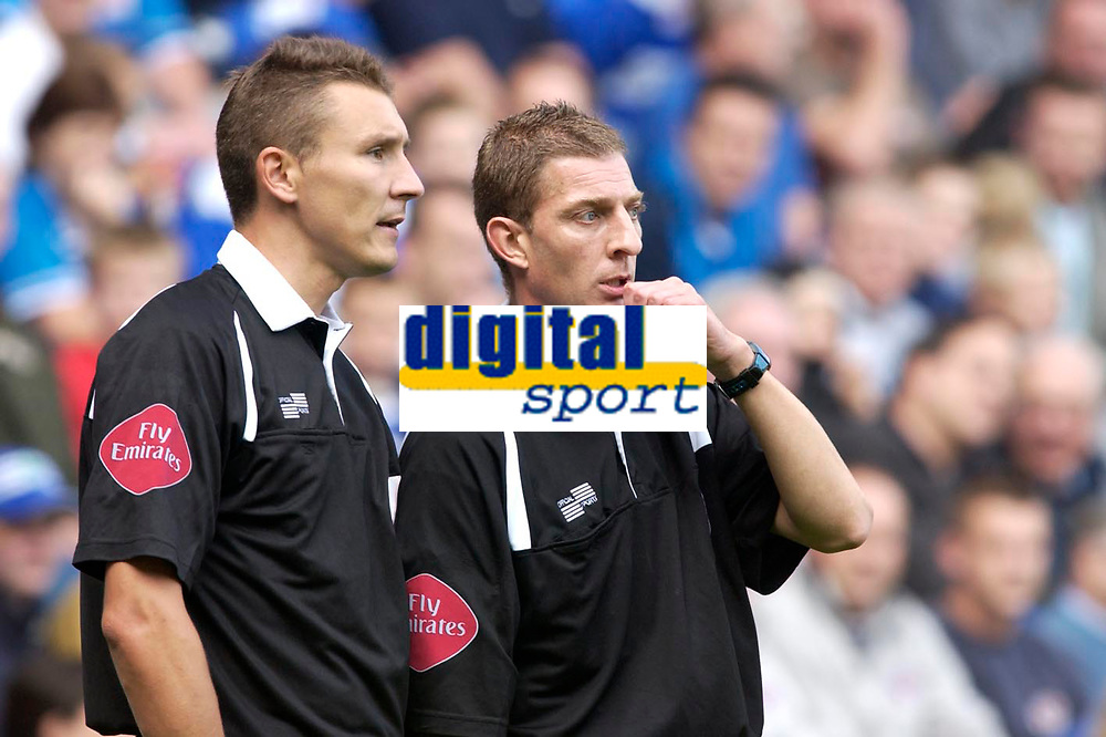 Photo: Daniel Hambury.<br />Reading v Ipswich Town. Coca Cola Championship.<br />16/10/2005.<br />Match referee Steve Tanner (R) and assistant S.P. Beck talk sabout an issue.