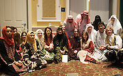 Performers in traditional Arabic dress await the begining of Arabic Culture Night at the new Baker Center.