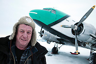 Yellowknife, Northwest Territories, Canada, February 2012. Bush Pilot 'Buffalo' Joe McBryan one of the original ice pilots on the North started flying planes at age 15. The Douglas DC-3, otherwise known as a C-47, Dakota, or Gooney Bird, made its first flight on December 17, 1935, over sixty years ago. Since that day, DC-3's have been flying all over the world, hauling freight and passengers to every corner of the globe. This aircraft went into production at a time of war, the second World War. The 1940's 1950's vintage transport aircraft of Buffalo Airways service the remote airstrips in the Arctic outposts and villages of Northern Canada. They have been immortalized by Ice Pilots NWT, the popular reality TV series. Photo by Frits Meyst/Adventure4ever.com