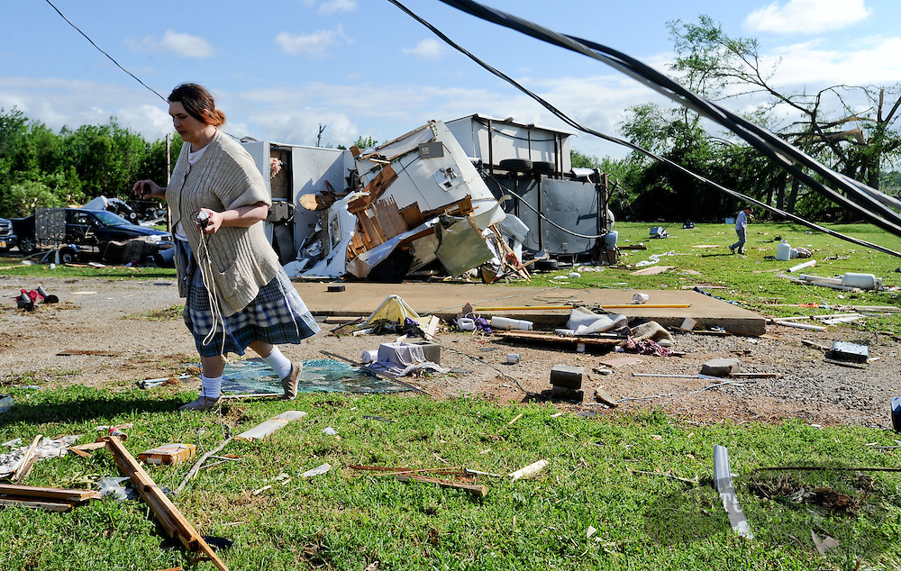 Daily Photo by Gary Cosby Jr.  ..Residents in Swan Creek, a mobile home community on Highway 31 near Tanner, Ala., recover belongings Thursday, April 28, 2011 left from Wednesday's destructive tornado.  Maria Bohanan walks through the destruction where her mobile home once stood.