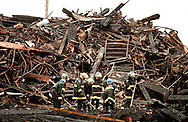 TGFIRE Firefighters, under direction of the State Fire Marshall, rake through debris as it is removed from the warehouse. Shoot date 12/14/99<br /> <br /> 12/15/99 Cutline: Working yesterday under the direction of the state Fire Marshal's office, firefighters rake through the debris from the former Worcester Cold Storage warehouse as it is removed from the site.