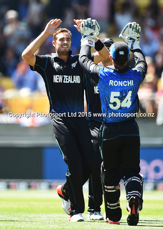 Tim Southee celebrates the wicket of Moeen Ali during the ICC Cricket World Cup match between New Zealand and England in Wellington, New Zealand. Friday 20 February 2015. Copyright Photo: Andrew Cornaga / www.Photosport.co.nz