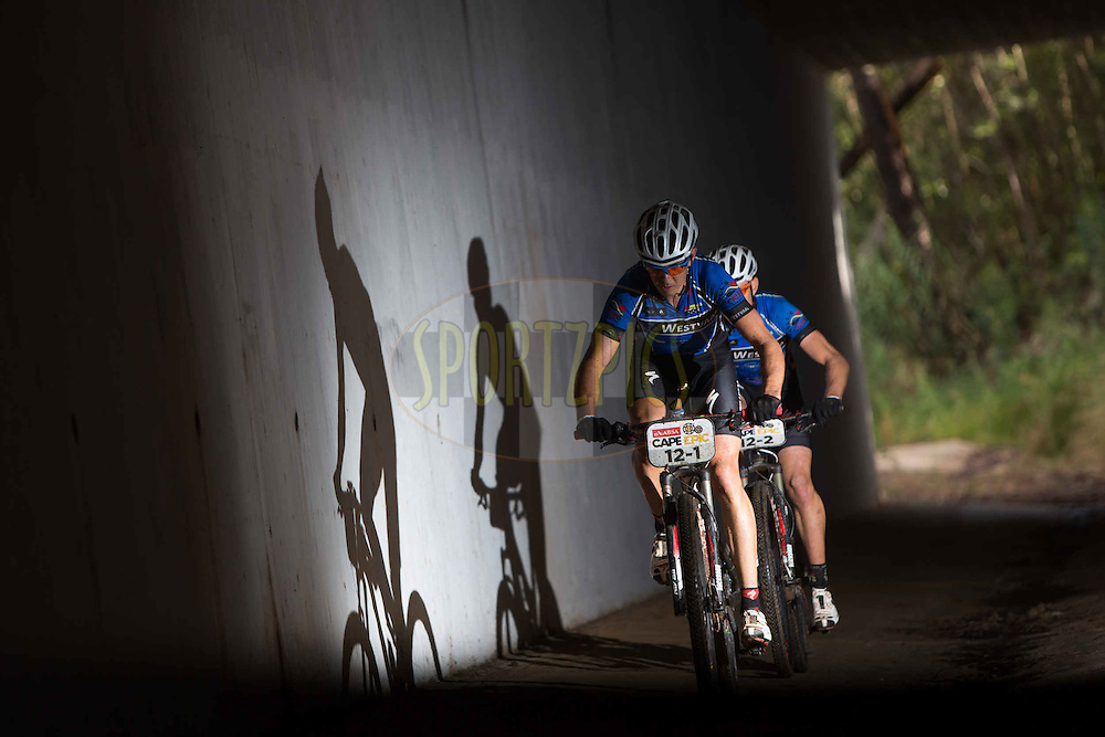 Nico Bell and Gawie Combrink (Westvaal Bells Cycling) make make their way through a tunnel during stage 6 of the 2013 Absa Cape Epic Mountain Bike stage race from Wellington to Stellenbosch, South Africa on the 23 March 2013..Photo by Karin Schermbrucker/Cape Epic/SPORTZPICS