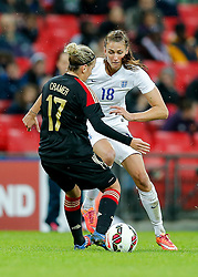 Jill Scott of England is tackled by Jennifer Cramer of Germany - Photo mandatory by-line: Rogan Thomson/JMP - 07966 386802 - 23/11/2014 - SPORT - WOMEN'S FOOTBALL - Wembley Stadium - England v Germany - Breast Cancer Care International Friendly Match.