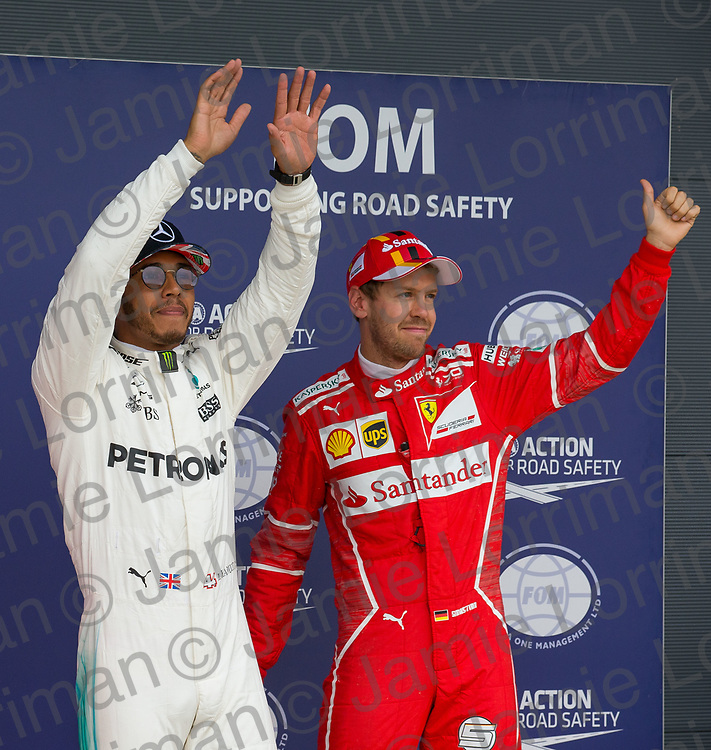 The 2017 Formula 1 Rolex British Grand Prix at Silverstone Circuit, Northamptonshire.<br /> <br /> Pictured: Mercedes AMG Petronas Driver Lewis Hamilton celebrates qualifying in pole position as Ferrari's Sebastian Vettel places third on the grid at the British F1 Grand Prix.<br /> <br /> Jamie Lorriman<br /> mail@jamielorriman.co.uk<br /> www.jamielorriman.co.uk<br /> +44 7718 900288