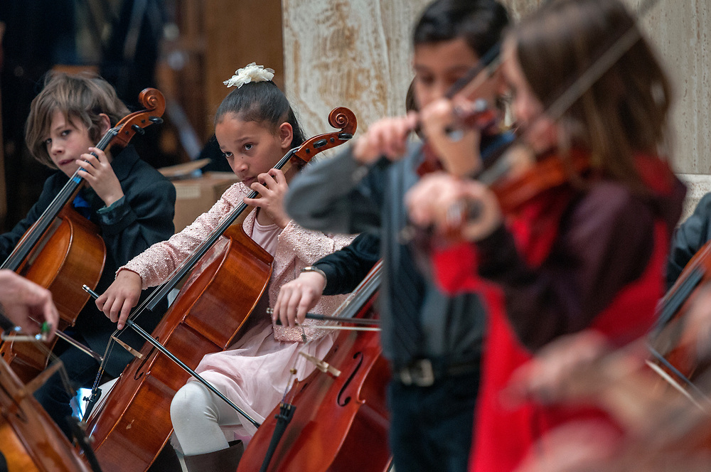 em020818c/a/Katiyana Goslow, a 5th grader, and other members of the Montessori Elementary and Middle School Strings perform in the Rotunda of the State Capitol in Santa Fe, Thursday February 8, 2018.  (Eddie Moore/Albuquerque Journal)