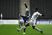 Wycombe Wanderers midfielder Alex Pattison (8) tries to pass under pressure from Milton Keynes Dons striker Kieran Agard (14) during the EFL Trophy match between Milton Keynes Dons and Wycombe Wanderers at stadium:mk, Milton Keynes, England on 12 November 2019.
