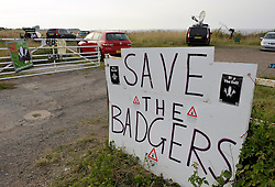 © Licensed to London News Pictures. 27/08/2013. Watchet, Somerset, UK.  Badger Cull. Sign on the gate of the protest Camp Badger near Watchet. Campaigners against the badger cull go on evening and night patrols to look for signs of badgers and badger setts and to deter the teams of marksmen who are carrying out the licensed shooting of badgers.  The cull is a pilot trial in West Somerset and West Gloucestershire with the eventual aim of reducing bovine turberculosis in cattle. 27 August 2013.<br /> Photo credit : Simon Chapman/LNP
