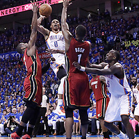12 June 2012: Oklahoma City Thunder point guard Russell Westbrook (0) goes for the shot in the traffic past Miami Heat shooting guard Dwyane Wade (3) and over Miami Heat power forward Chris Bosh (1) during the second half of Game 1 of the 2012 NBA Finals between the Heat and the Thunder, at the Chesapeake Energy Arena, Oklahoma City, Oklahoma, USA.